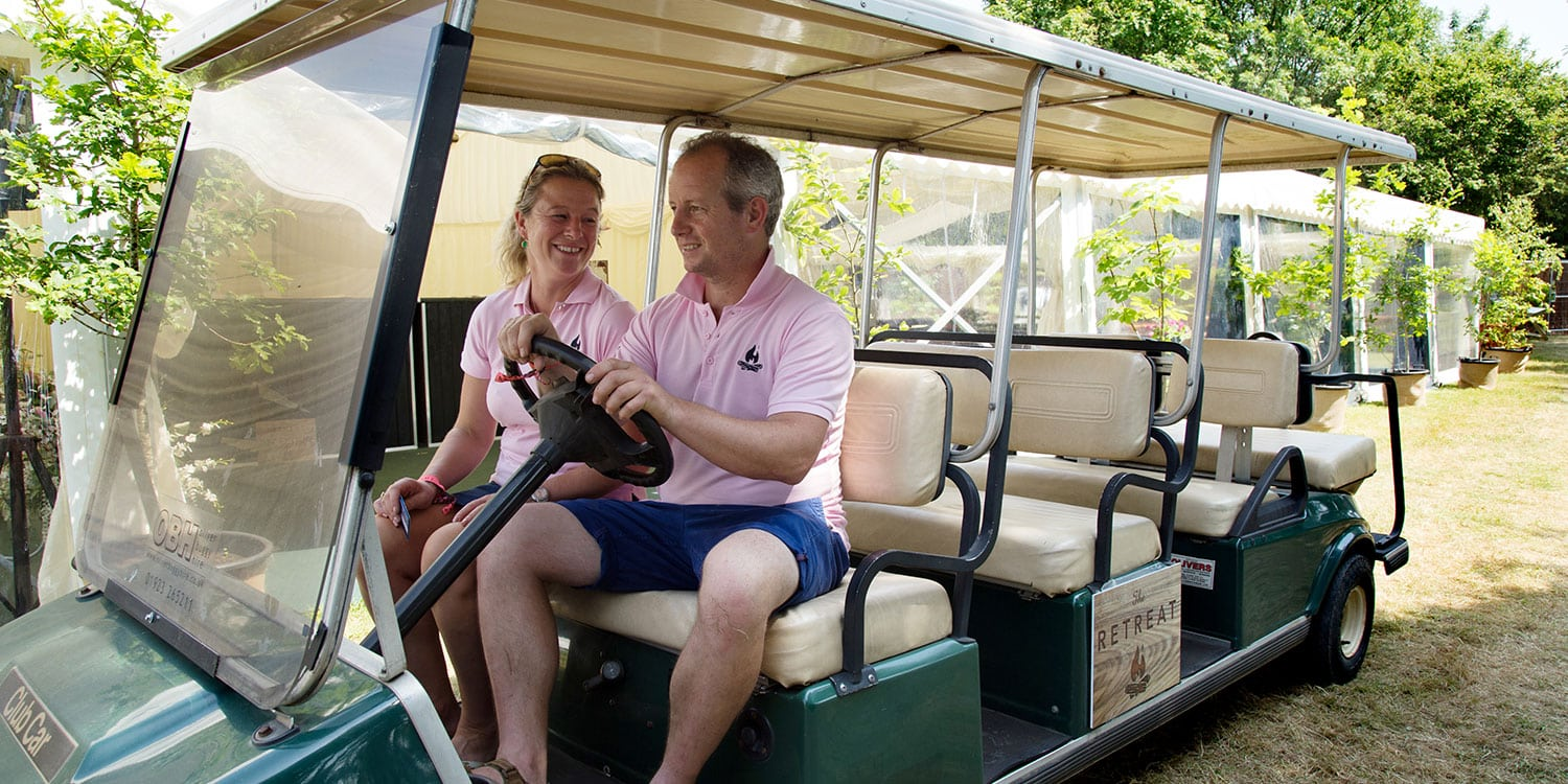 Barny & Emily Lee on the golf buggy at The Retreat, Glastonbury Festival
