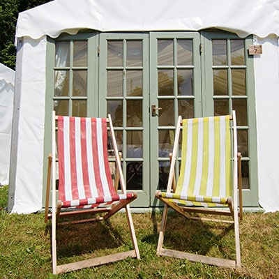 Deckchairs outside on of The Retreat Frame tents - luxury glamping
