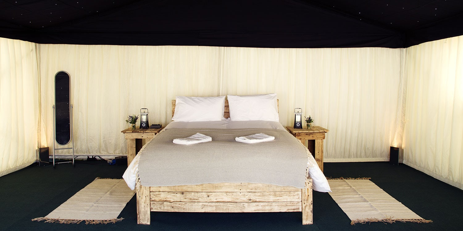 A luxury frame ten with wooden double bed and proper matress! Glamping with The Retreat at Glastonbury