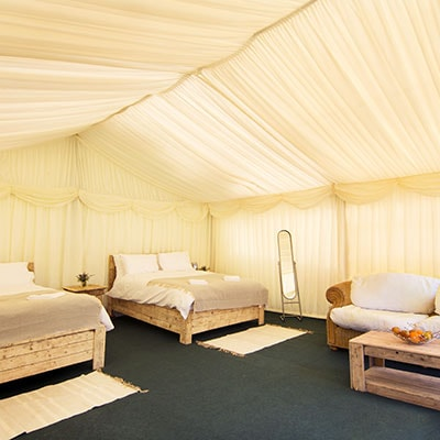 A luxury frame tent at The Retreat, Pilton, pop up glamping site for Glastonbury Festival 2019