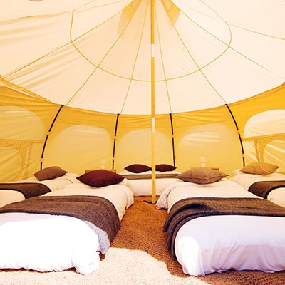 The interior of a Lotus Belle Tent which can sleep up to 6 people for glamping at Glastonbury Festival