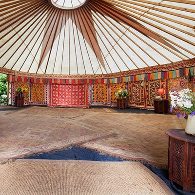 A large yurt - available for groups of up to four glampers for luxury camping at Glastonbury festival