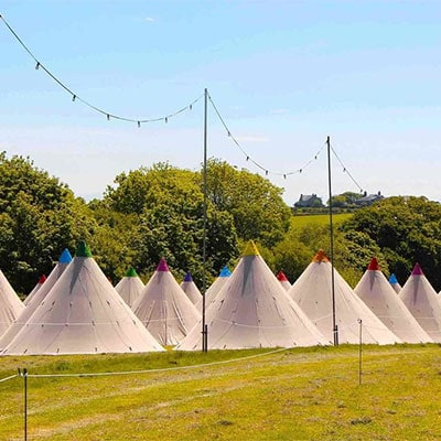 Tipis in a glamping fields outside of Glastonbury Festival