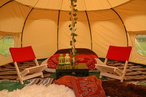 Guest bell tent for two people photo with two deckchairs