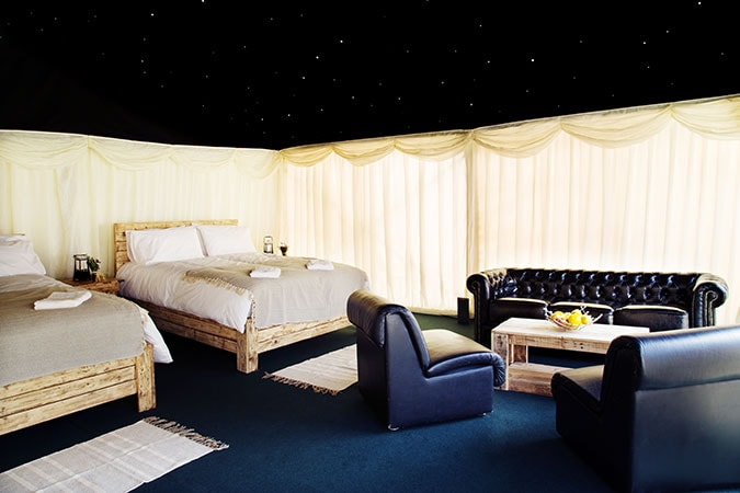 Safari Starlight luxury tent for 2 guests showing double bed and starlight roof