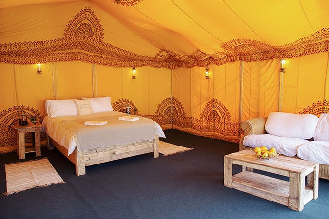 Safari India Theme luxury tent for 2 guests, shows interior with Indian pattern and bright colours