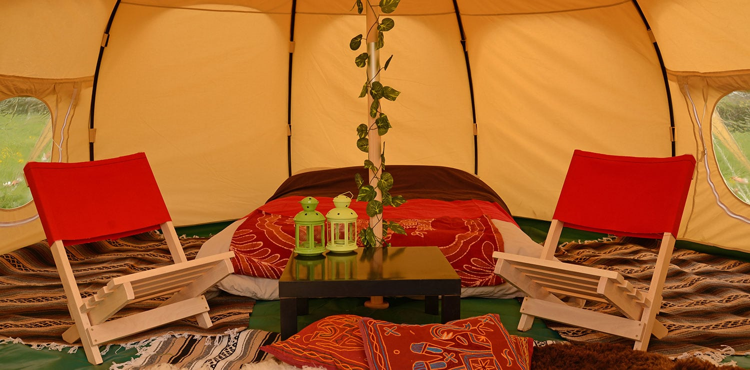 The interior of a Lotus Belle tent at The Retreat, Glastonbury festival luxury glamping