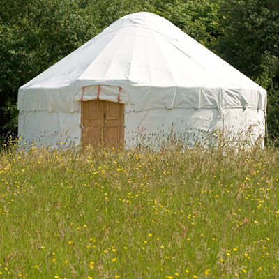 A 4 meter yurt in a glamping field for Glastonbury festival