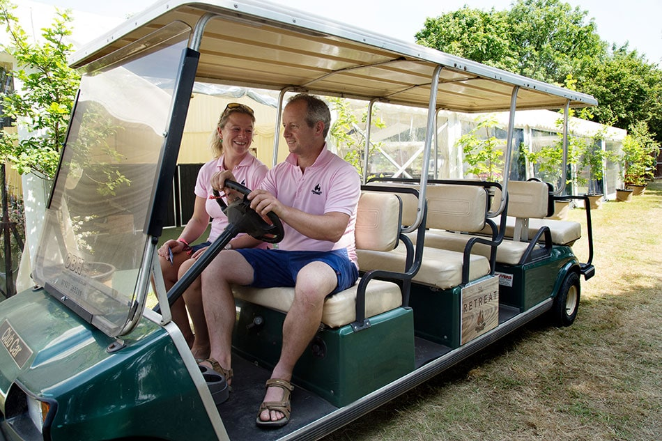 Barny and Em having some fun on the glamp site golf buggy
