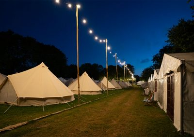 The glamping field at dusk