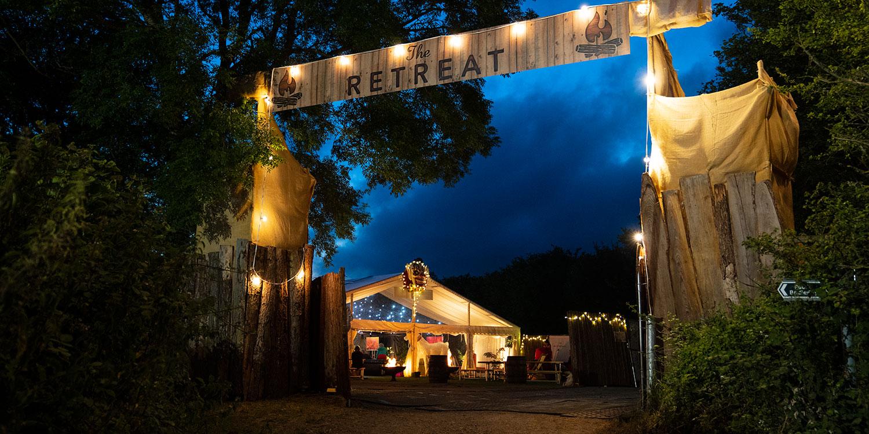 The Glastonbury Retreat entrance at night time