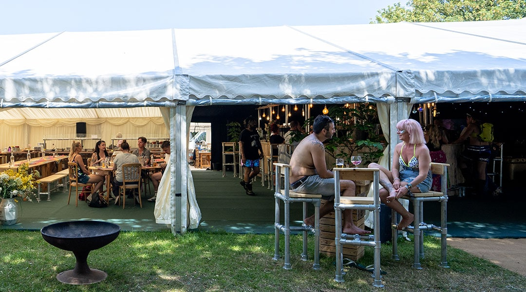 Guests enjoying the bar and restaurant at The Glastonbury Retreat