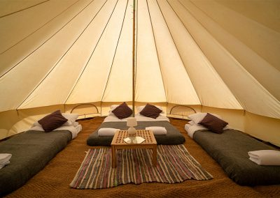 Interior of a 5 metre Bell tent at The Glastonbury Retreat