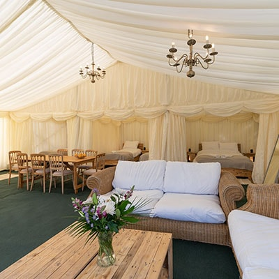Open plan living area of tent house for glamping at Glastonbury Festival