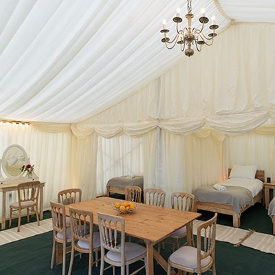 Open plan dressing and dining room area in tent house to rent for Glastonbury Festival at The Retreat